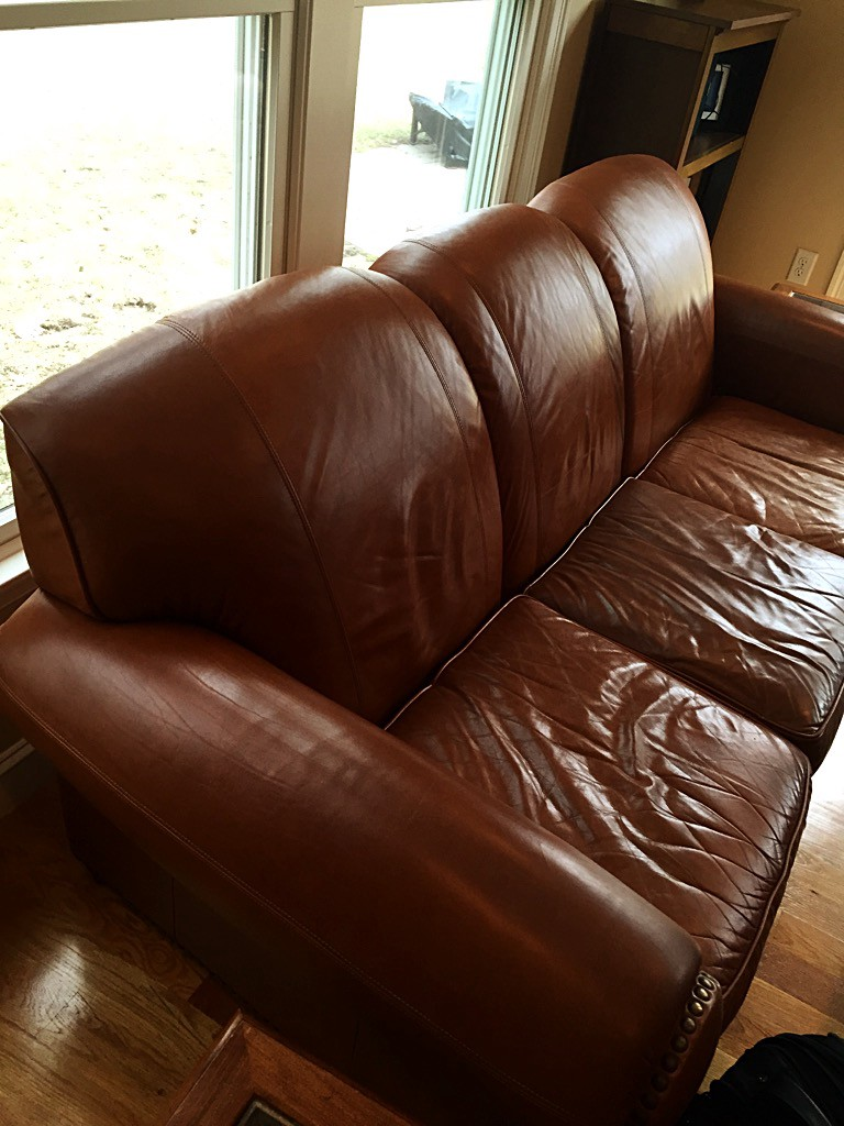 Here She Is In All Her Glory My Father S Luxurious Leather Couch I Can Practically Hear It Moo Ing