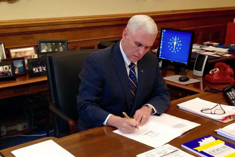 Image result for governor pence signing bill