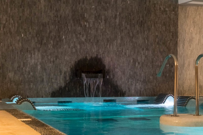 Thermal lounge chairs in the hydro therapy pool