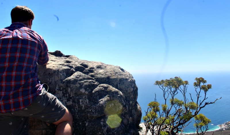tourist standing at top of table mountain