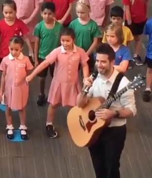 For five minutes of smiling, watch Nick lead the children.