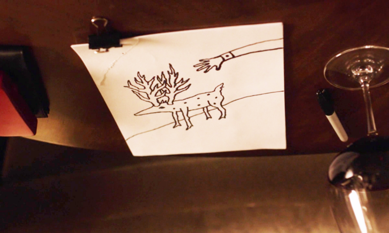 Gordons drawing of a creature with spots, antlers, on a hill, with an arm stretching towards it