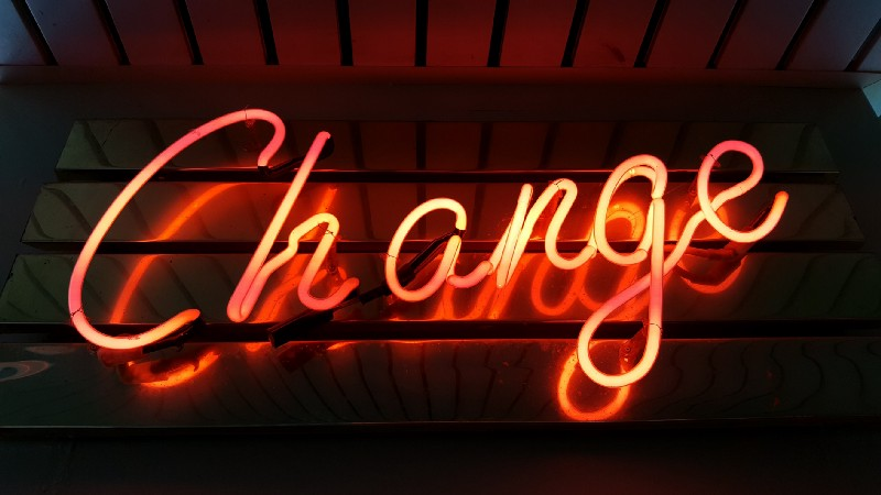 a neon sign that says change
