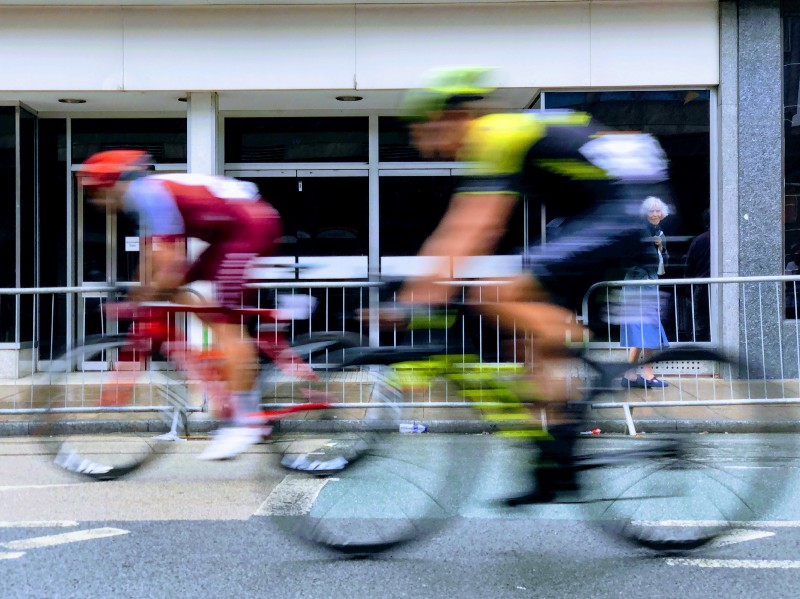 Two cyclists racing, like competitors on dating sites compete for the ladies' attention.