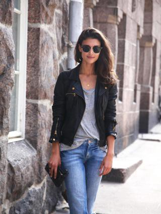 a girl with black real leather jacket