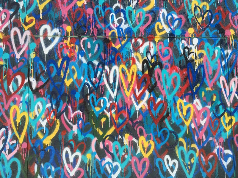 Multi-colored spray painted hearts