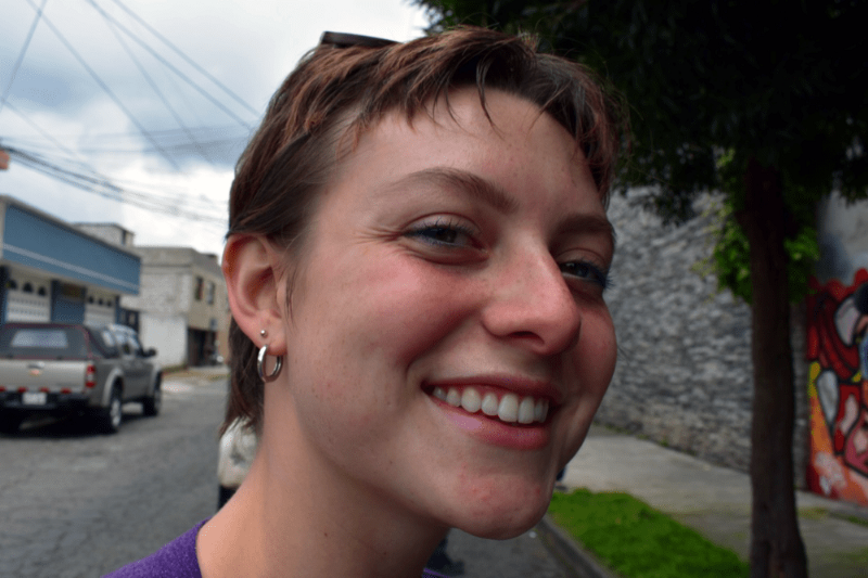 a girl with short hair smiling