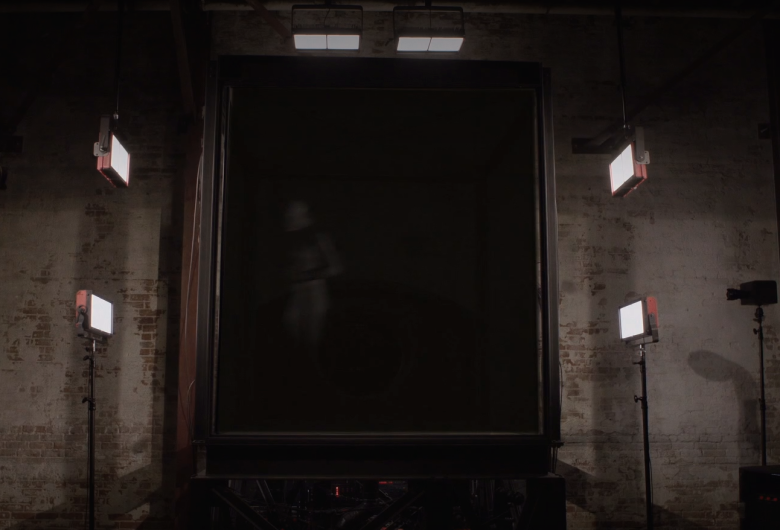 a female figure appears in the black box