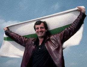 Douglas Adams holding up a towel