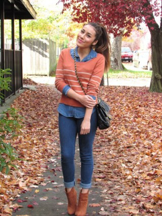 a women with orange top and perfect jeans