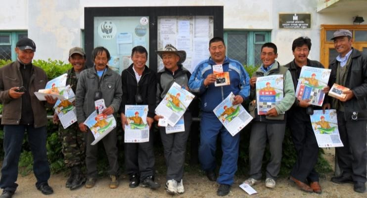 Members of a fishing club proudly holding the Pride campaign materials