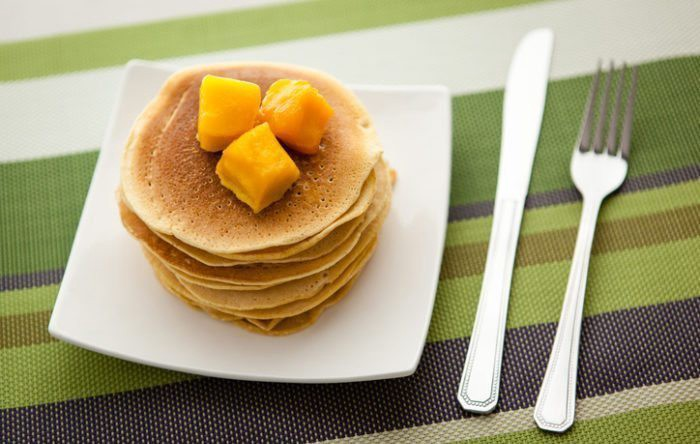 High-protein pancakes made from chickpea/garbanzo bean/gram flour topped with mangoes.