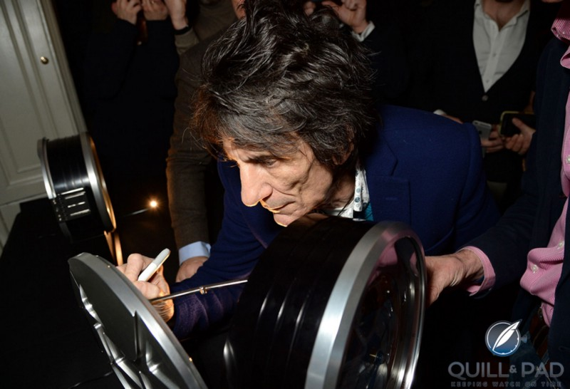 Ronnie Wood signs the second Bremont B-1 clock featuring one of his hand-painted dials during the brand's Townhouse event (photo courtesy Richard Young)