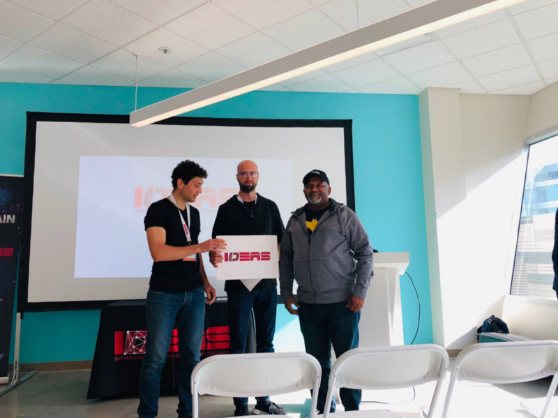 winners of hackathon holding a the IDEAS sign