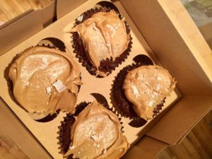 Milk chocolate cupcakes with caramel frosting, dusted with flaked sea salt. A Ken favorite.
