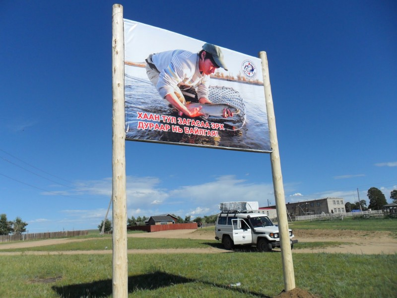 Billboards featuring images of well-known and highly respected local fishermen