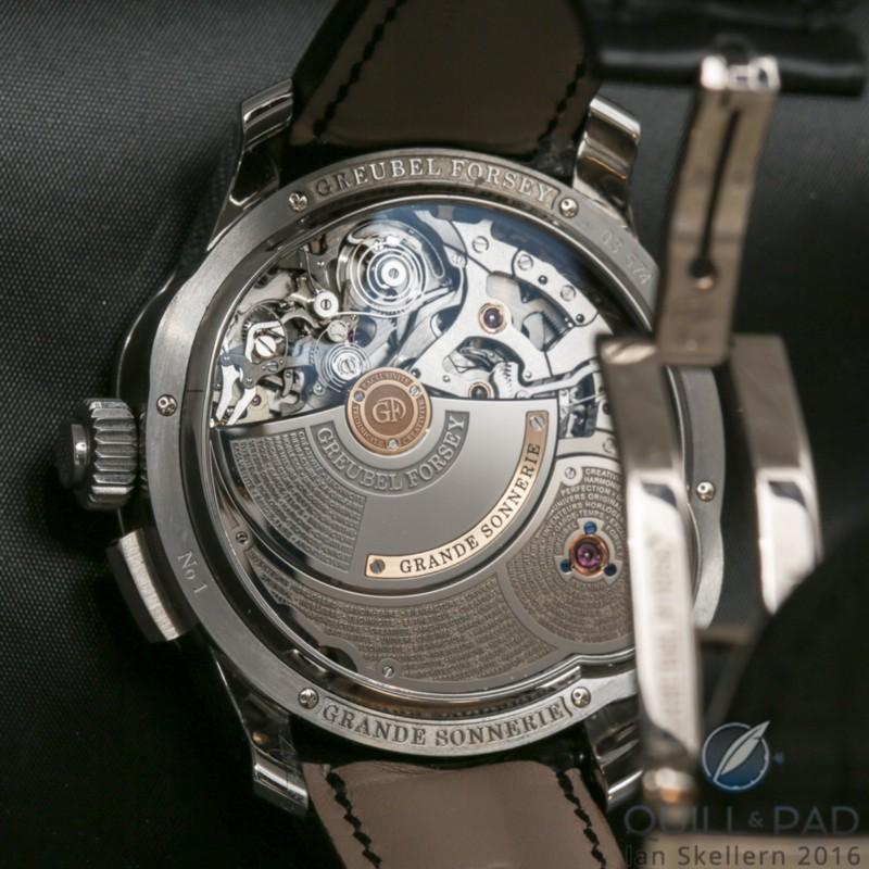 "View through the display back to the movement of the Greubel Forsey Grande Sonnerie with the large ""mini"" rotor to wind the chiming mechanism on the left"