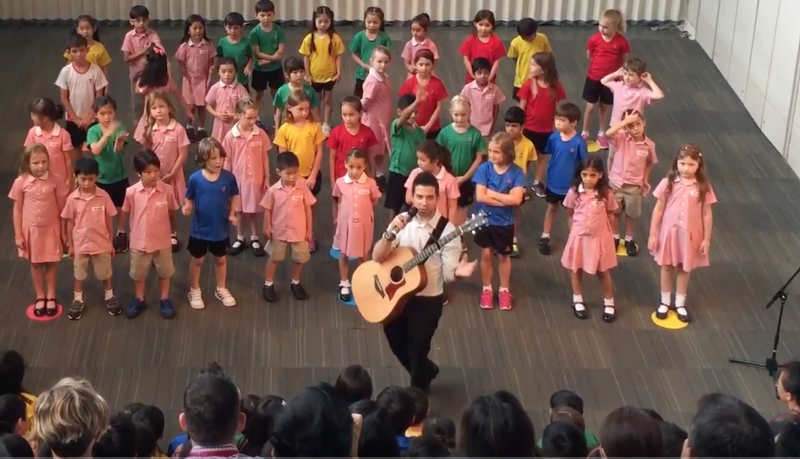 Nick Staff leading the Canadian International School of Hong Kong, Grade 1 Assembly
