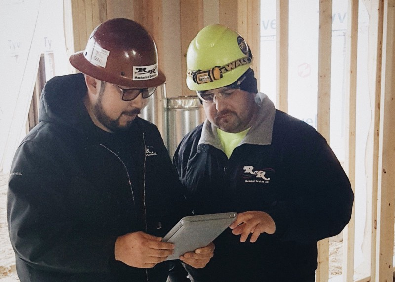 R&R on the jobsite, pulling up their safety manuals on PlanGrid