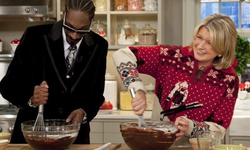 """In this Dec. 15, 2009, publicity image released by The Martha Stewart Show, host Martha Stewart, right makes brownies with Snoop Dogg during an appearance on """"The Martha Stewart Show,"""" in New York. The segment will air on Friday. (AP Photo/The Martha Stewart Show, Nick D.) ORG XMIT: NYET977"""