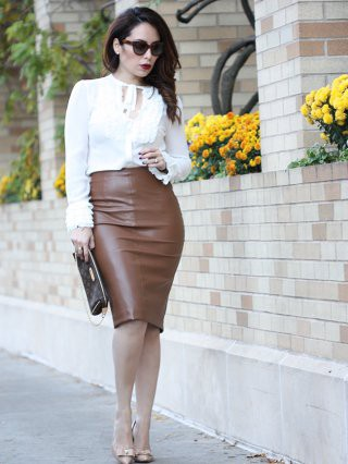 a women white shirt and pencil skirt