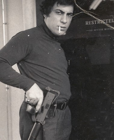 Above - Paris Theodore models a holster for a MAC-10 submachine gun. 401 Films photo. At top - A Secret Service agent holds a previously concealed Uzi during the attempt on President Ronald Reagan's life in 1981. Reagan Library photo.