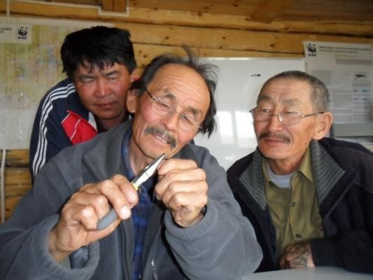 Fishermen practicing how to bend barbs on a hook