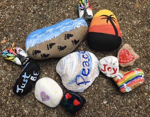 Rock painting done with inspirational messages and designs