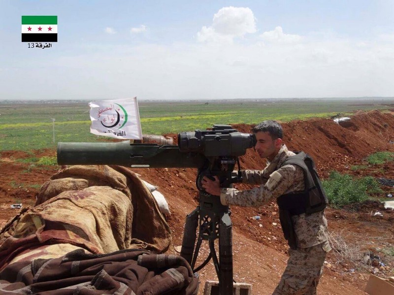 A FSA Division 13 TOW gunner in Mare' with a Firqat al-Amiyn al-Ulwlaa Halab banner in the background, an example of the intense Syrian Opposition cooperation that has enabled Mare' to remain a bastion of the Revolution despite being surrounded by hostile ISIS and YPG dominated forces