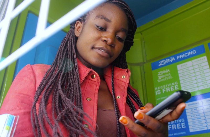 Annetty Chama works in a Zoona kiosk in Lusaka