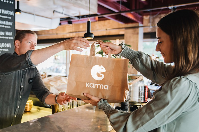 Karma customer picking up her food