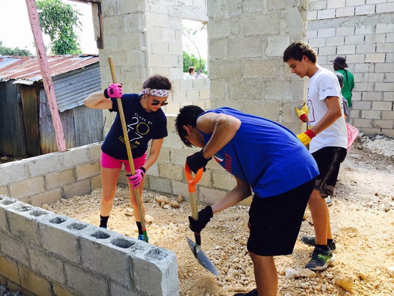 Interact Club of St. Joseph High School Past President, Taylor Huie and Members Donovan Cool and Patrick Sohn work on the house built for a multi-generation family in La Romana, Dominican Republic