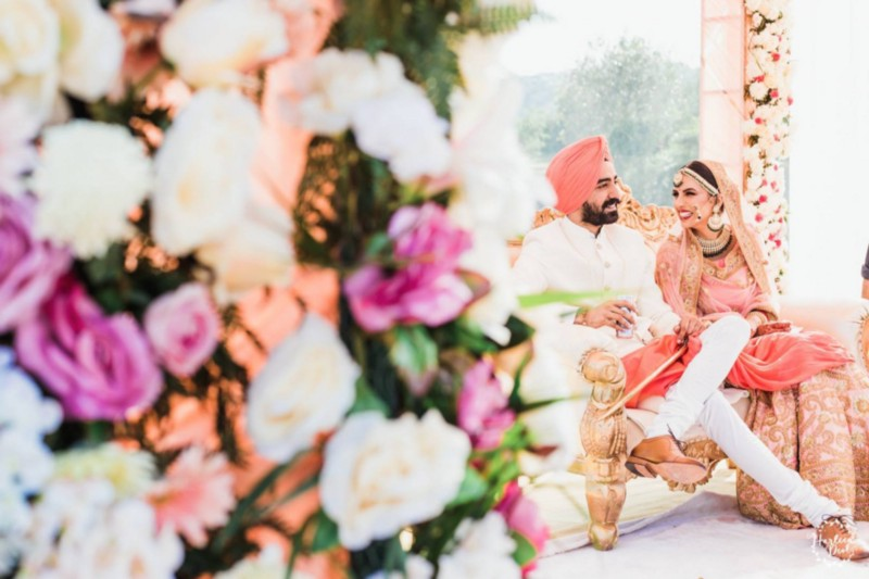 Bride & Groom wearing Salmon Pink colored outfits