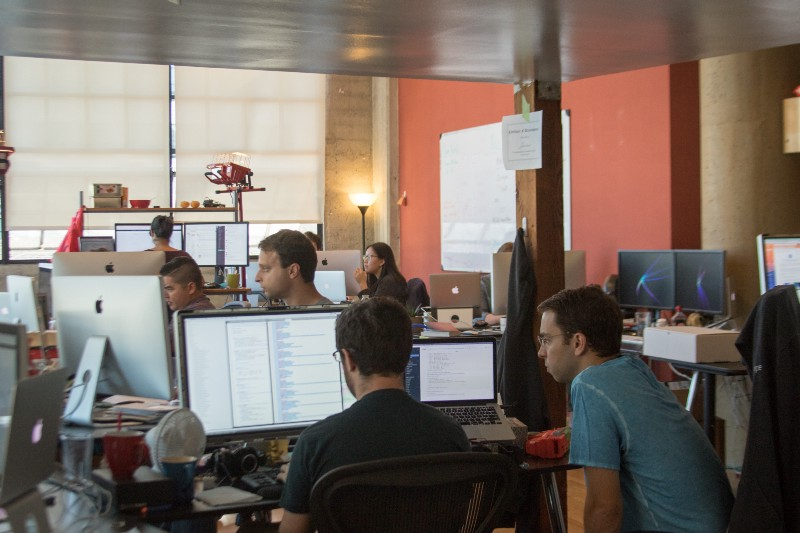 "‍The aforementioned ""young startup team,"" hard at work at our SOMA headquarters."