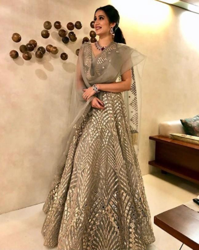 Sagarika's lehenga by Falguni Shane Peacock in pastel color