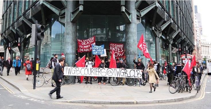 Cycle couriers campaigning outside a client's offices