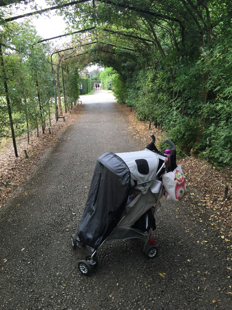 Baby in pram with Snoozeshade covering