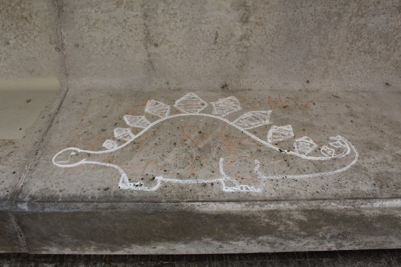 graffiti under bridge in Bellingham depicting a dinosaur