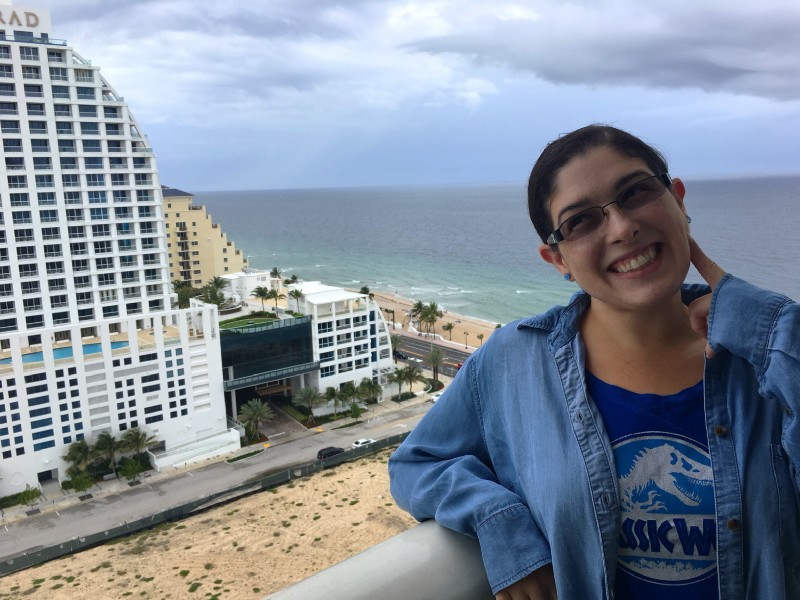 Me cheesing for the camera on the balcony of our suite