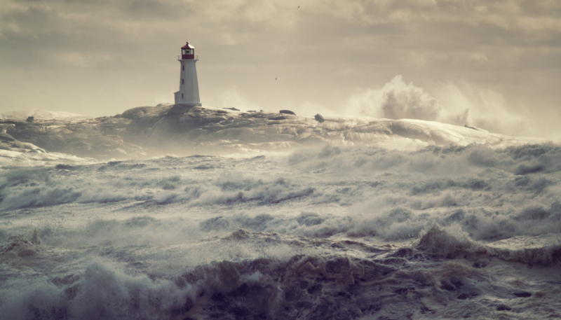 Rough waters and distant lighthouse