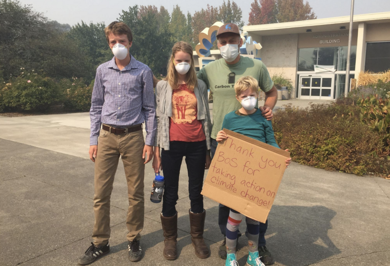 Park Guthrie (right) and his children, including Kai (left), attending a canceled Sonoma County Board of Supervisors during the 2017 Tubbs fire. Source: Schools for Climate Action