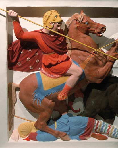 Ancient Greek sculpture of soldier on a horse during a battle with lance in his right hand