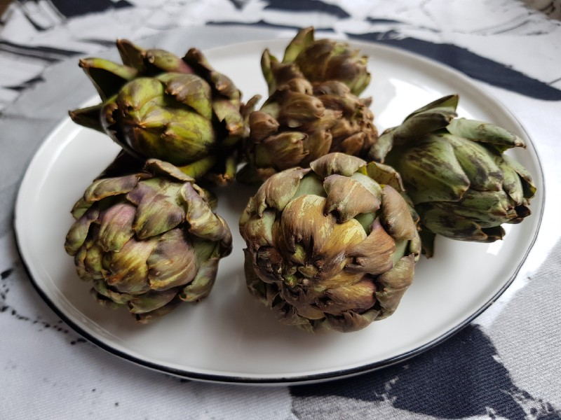 A plate filled with artichokes
