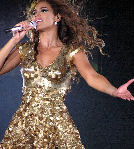 beyonce with shinny one piece on a concert
