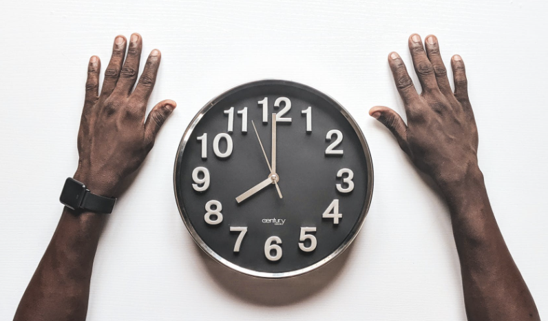 Hands and a clock. Because DesignOps enabled organisational ambidexterity by streamlining processes and improving time utilisation.