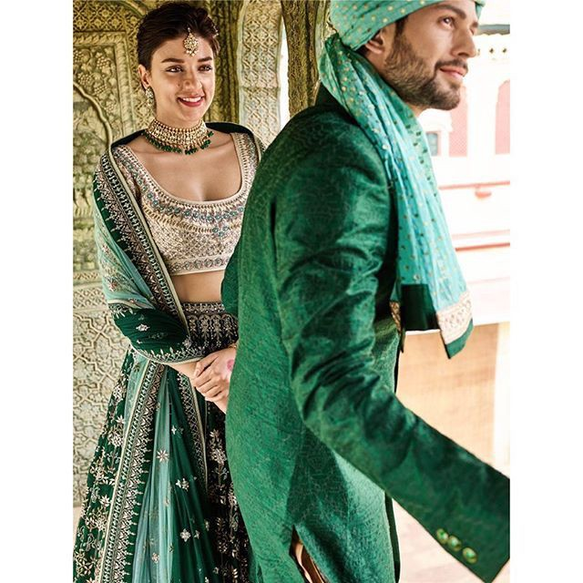 Bride and groom in green color coordinated outfits