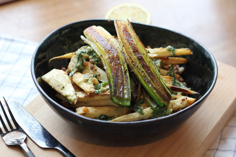 A bowl with roasted parsnip salad