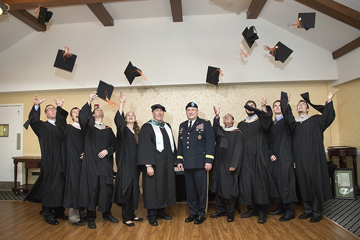 Hats off to the first graduates of the Armament Graduate School at Picatinny Arsenal, New Jersey. The first class of the Armament Graduate School, part of the U.S. Army Armament Research Development and Engineering Center graduates Sept. 10 at Picatinny Arsenal, New Jersey. Joining the students (center left ) Mr. John F. Hedderich III, director of ARDEC and (center right) Maj. Gen. John F. Wharton, Commanding General, U.S. Army Research, Development and Engineering Command. (U.S. Army photo by Erin Usawicz)