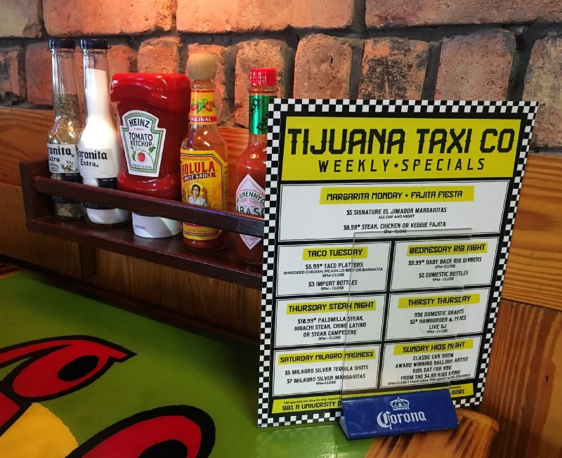 Condiment rack, Corona salt shaker, Corona pepper shaker, Heinz Ketchup, Cholula Hot Sauce, Tobasco Sauce, Specials