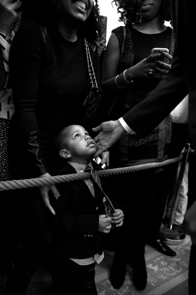 "Feb. 18, 2016 ""I had my eye on this youngster while President Barack Obama spoke during a reception at the White House celebrating African American History Month. When the President starting greeting audience members along the rope line, I bent down in front of the young man and captured this moment of the President touching his face before he too bent down to greet him. Afterwards, I tracked down his name — Clark Reynolds — and had the President sign a copy for him."" (Official White House Photo by Pete Souza)"